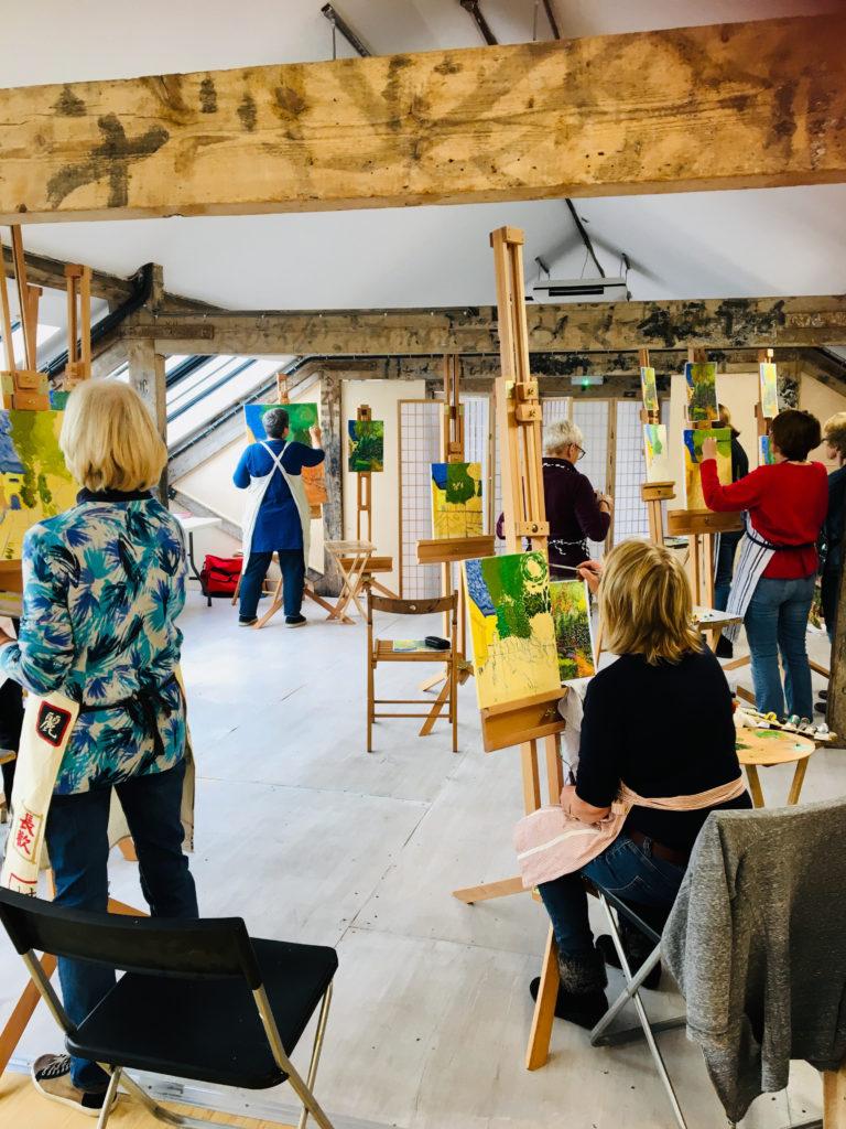 Sarah Wimperis leading an art class at Pegasus Art shop near Stroud