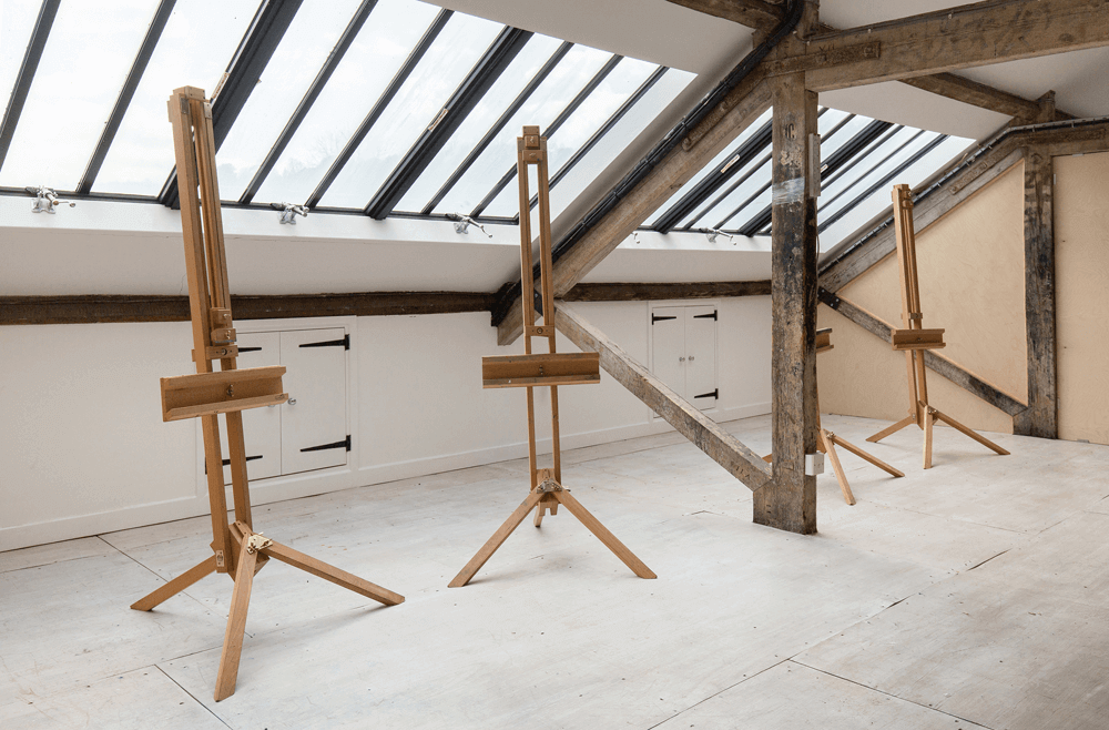Pegasus Art Attic Studio for hire - empty easels in large studio space under window