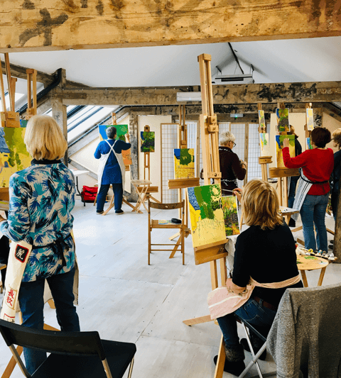 Pegasus Art Attic Studio for hire - artists painting on easels in large studio space
