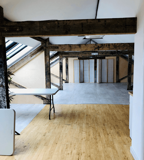 Pegasus Art Attic Studio room for corporate hire - large light space with windows, cross beams and tables