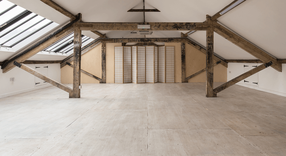 Pegasus Art Attic Studio room for corporate hire - large light space with windows, cross beams and screen