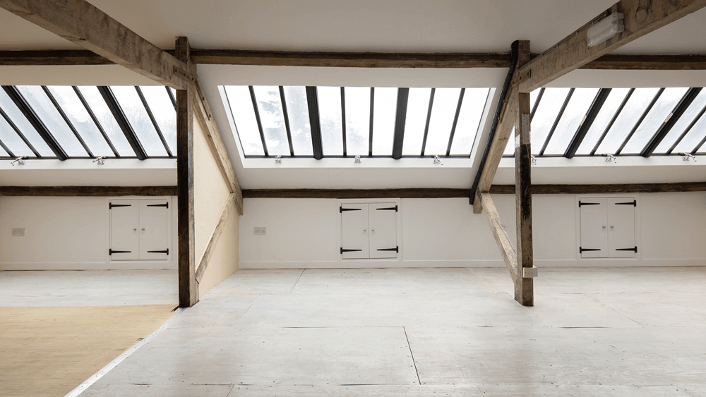 Pegasus Art Attic Studio room for corporate hire - large light space with windows, cross beams and eves cupboards