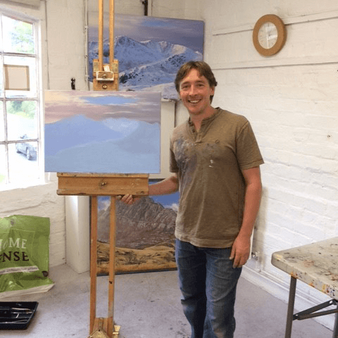 David 'DJ' Johnson standing next to painting on easel