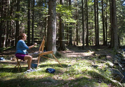 lady sitting in woodland painting