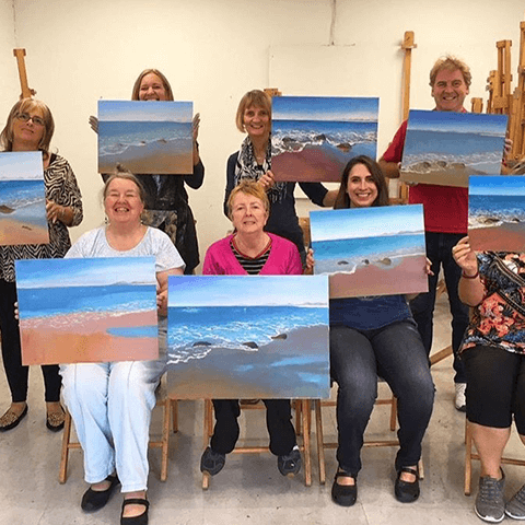 David 'DJ' Johnson students with paintings at seascape workshop
