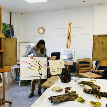Fiona McIntyre holding example artwork in workshop