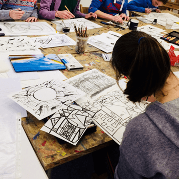 Imogen Harvey-Lewis students around table drawing