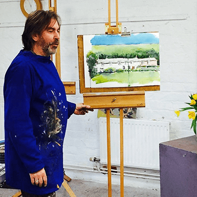Max Hale infront of an easel