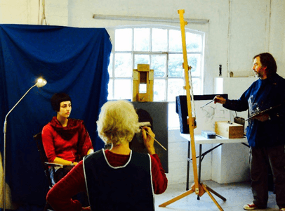 Mac Hale painting at easel with life model