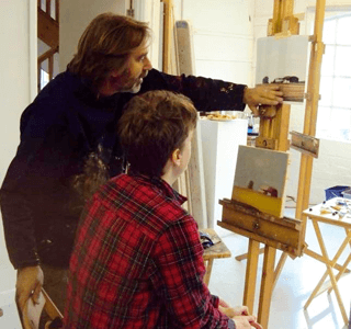 Max Hale teaching a student in front of an easel