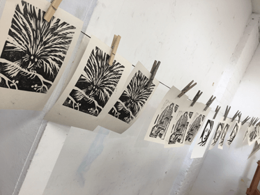 Rod Nelson woodblock printing class - prints hanging on line