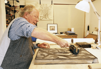 Rod Nelson rolling ink on woodblock