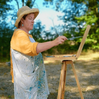 sarah wimperis - standing at easel painting